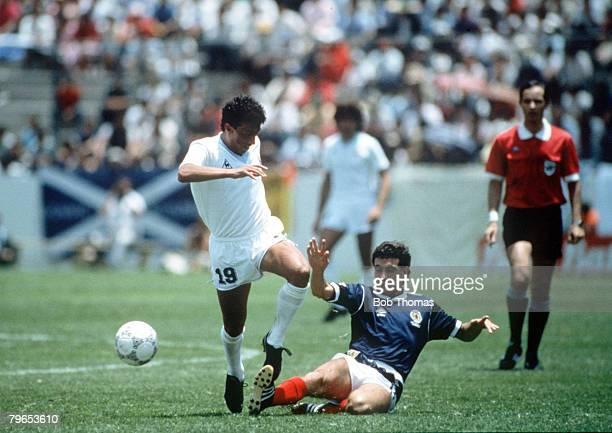 World Cup Finals Neza Mexico 13th June Uruguay 0 v Scotland 0 Uruguay's Venacio Ramos is tackled by Scotland's Paul McStay