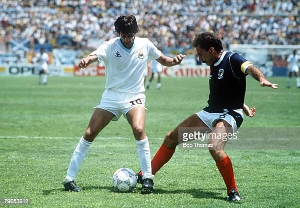 World Cup Finals Neza Mexico 13th June Uruguay 0 v Scotland 0 Scotland's Willie Miller challenges Uruguay's Enzo Francescoli for the ball