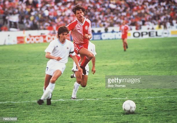 World Cup Finals Neza Mexico 8th June Denmark 6 v Uruguay 1 Denmark's Frank Arnesen leaps high after a challenge from Uruguay's Eduardo Acevedo