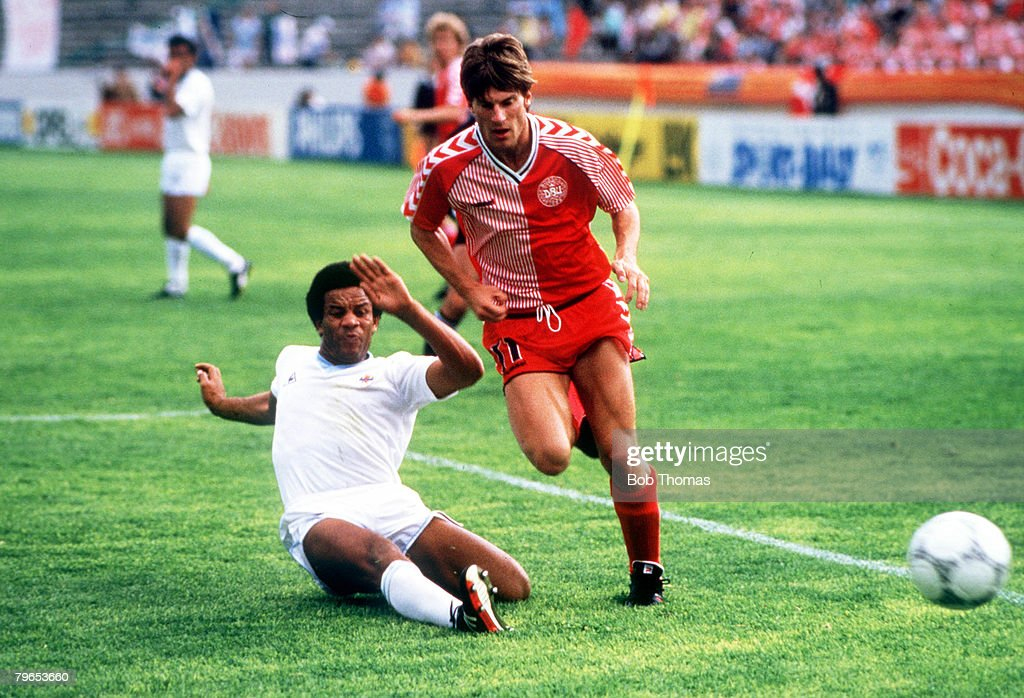1986 World Cup Finals, Neza, Mexico, 8th June, 1986, Denmark 6 v Uruguay 1, Denmark's Michael Laudrup avoids a sliding challenge from Uruguay's Victor Diogo : News Photo