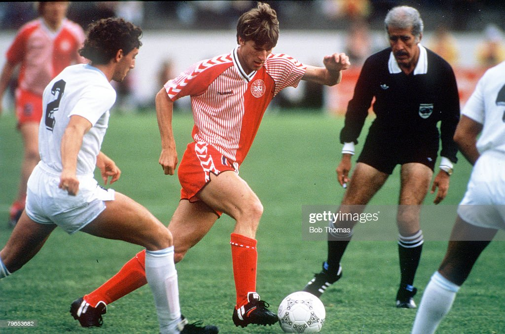 1986 World Cup Finals, Neza, Mexico, 8th June, 1986, Denmark 6 v Uruguay 1, Denmark's Michael Laudrup is marked closely by Uruguay's Nelson Guttierez : News Photo
