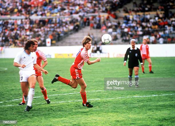 World Cup Finals Neza Mexico 8th June Denmark 6 v Uruguay 1 Denmark's Michael Laudrup controls the ball watched by Uruguay's Nelson Guttierez