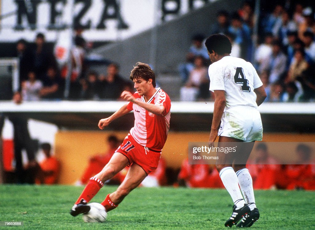 1986 World Cup Finals, Neza, Mexico, 8th June, 1986, Denmark 6 v Uruguay 1, Denmark's Michael Laudrup controls the ball watched by Uruguay's Victor Diogo : News Photo