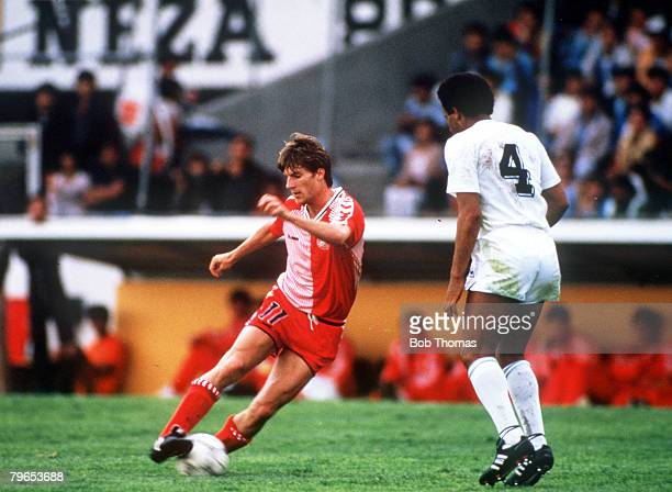 World Cup Finals Neza Mexico 8th June Denmark 6 v Uruguay 1 Denmark's Michael Laudrup controls the ball watched by Uruguay's Victor Diogo