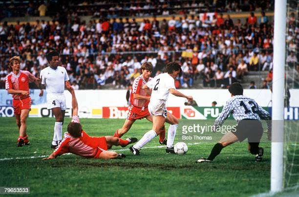 World Cup Finals Neza Mexico 8th June Denmark 6 v Uruguay 1 Uruguayan defender Nelson Gutierrez shields the ball from Denmark's Michael Laudup and...