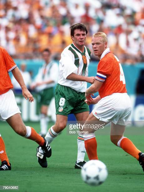 World Cup Finals Orlando USA 4th July Holland 2 v Republic of Ireland 0 Ireland's Ray Houghton watches the ball with Holland's Ronald Koeman
