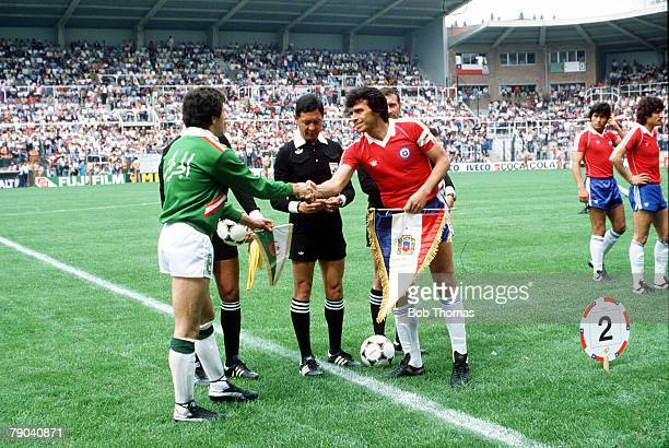 World Cup Finals Oviedo Spain 24th June Algeria 3 v Chile 2 Algerian captain Ali Fergani and Chilean captain Elias Figue Roa exchange pennants before...