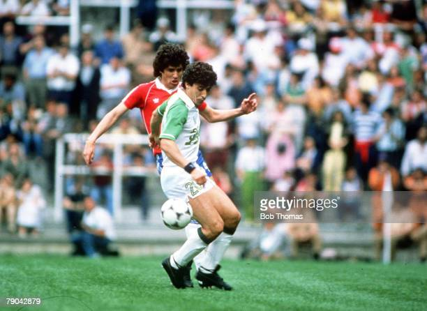World Cup Finals Oviedo Spain 24th June Algeria 3 v Chile 2 Algeria's Abdelmadjis Bourebbou is challenged by Chile's Vladimir Bigorra