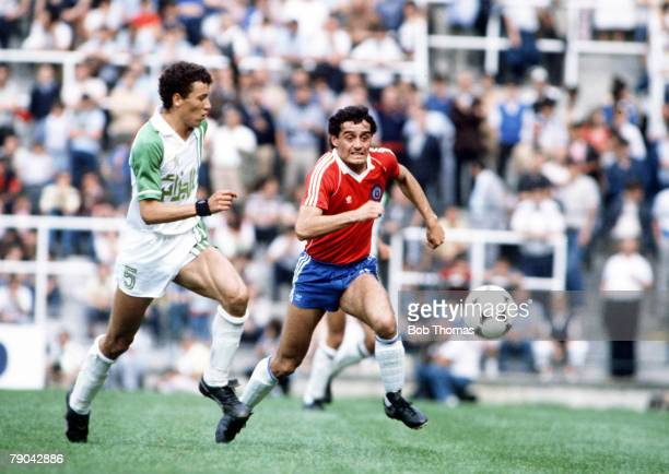 World Cup Finals Oviedo Spain 24th June Algeria 3 v Chile 2 Algeria's Chaabane Merzekane chases Chile's Gustavo Moscoso for the ball