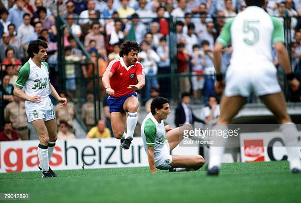 World Cup Finals Oviedo Spain 24th June Algeria 3 v Chile 2 Algeria's Nourredine Kourichi tackles Chile's Carlos Caszely as captain Ali Fergani looks...