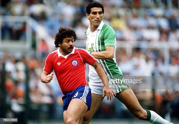 World Cup Finals Oviedo Spain 24th June Algeria 3 v Chile 2 Algeria's Nourredine Kourichi battles for the ball with Chile's Carlos Caszely