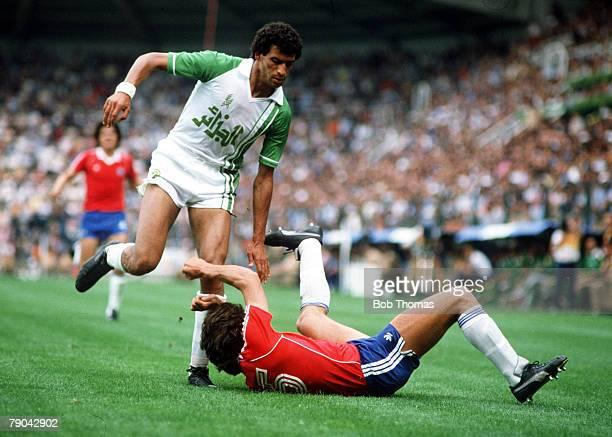World Cup Finals Oviedo Spain 24th June Algeria 3 v Chile 2 Algeria's Mammoud Guendouz stumbles over Chile's Patricio Yanez