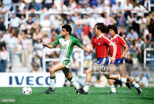 World Cup Finals Oviedo Spain 24th June Algeria 3 v Chile 2 Mario Galindo of Chile chases Algeria's Tedj Benasaoula for the ball