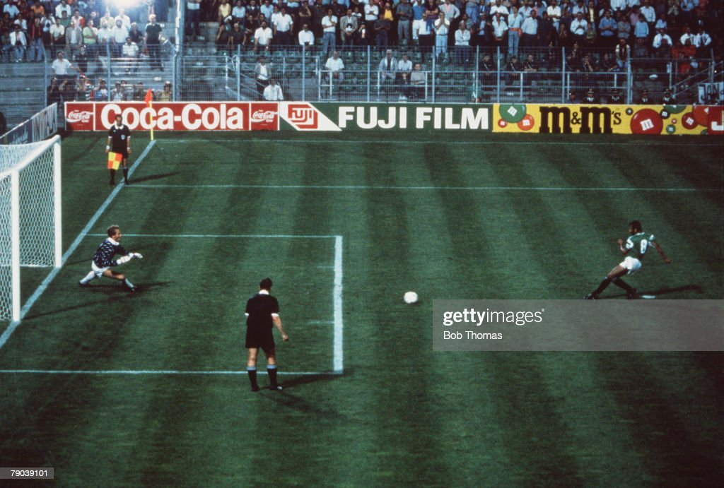 1990 World Cup Finals. Palermo, Italy. 12th June, 1990. Holland 1 v Egypt 1. Egypt's Magdi Abed El Ghani scores his side's equalising goal from the penalty spot past Dutch goalkeeper Hans Van Breukelen. : News Photo