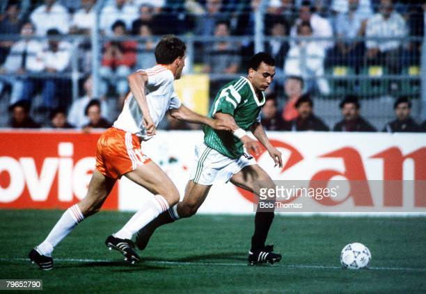 World Cup Finals Palermo Italy 12th June Holland 1 v Egypt 1 Egypt's Hossam Hassan takes the ball past Holland's Graeme Rutjes