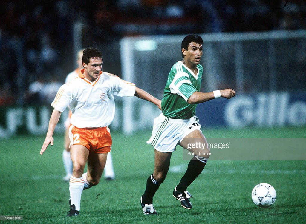 1990 World Cup Finals, Palermo, Italy, 12th June, 1990, Holland 1 v Egypt 1, Egypt's Abdel Hamid Gamal takes the ball past Holland's Barry Van Aerle : News Photo