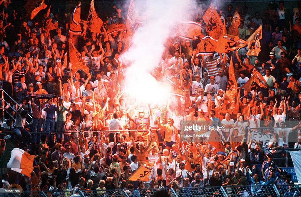 1990 World Cup Finals, Palermo, Italy, 12th June, 1990, Holland 1 v Egypt 1, Flares are lit in the Dutch section of the crowd : News Photo