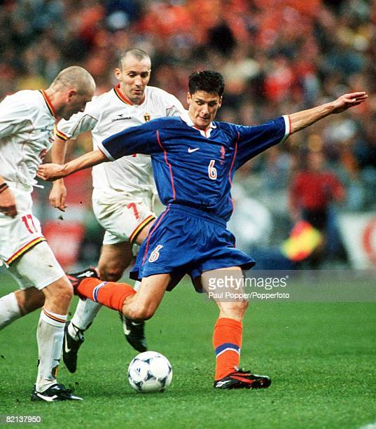 World Cup Finals Paris France 13th JUNE 1998 Holland 0 v Belgium 0 Belgium's Verstraeten and Wilmots close in as Holland's Wim Jonk shoots
