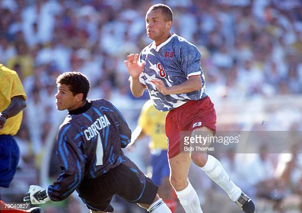 World Cup Finals Pasadena USA 22nd June USA 2 v Colombia 1 USA's Ernie Stewart beats Colombian goalkeeper Cordoba to score the winning goal of the...