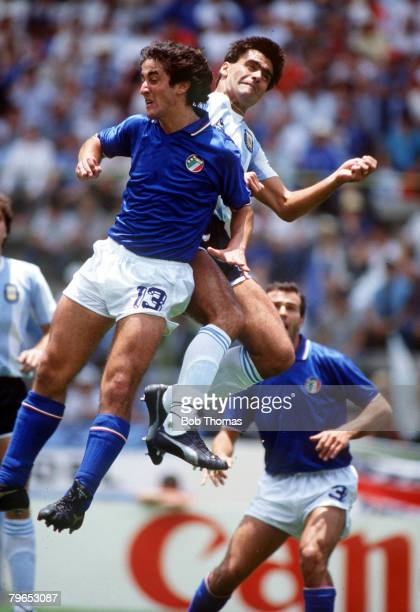 World Cup Finals Puebla Mexico 5th June Italy 1 v Argentina 1 Italy's Fernando De Napoli in a midair clash with Argentina's Jose Luis Brown