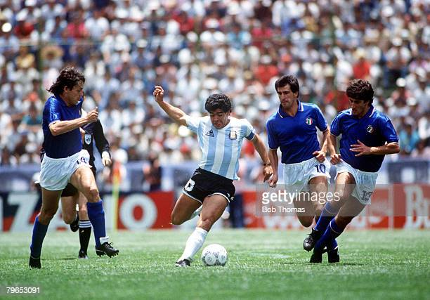 World Cup Finals Puebla Mexico 5th June Italy 1 v Argentina 1Argentina's Diego Maradona races between Italy's Antonio Di Gennaro and Fernando De...
