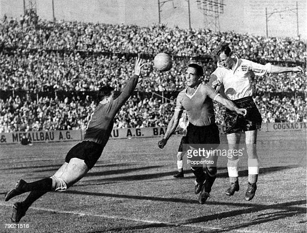 World Cup Finals, Quarter Final tie, Basle, 26th June 1954, England v Uruguay England forward Tom Finney, far right, jumps for a header with Uruguay...