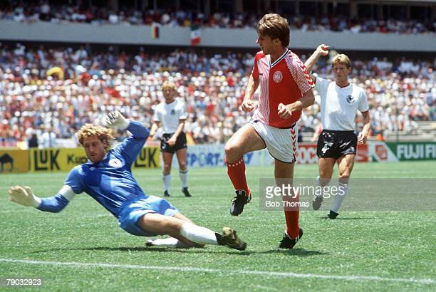 World Cup Finals Queretaro Mexico 13th June Denmark 2 v West Germany 0 Denmark's Michael Laudrup beats West Germany goalkeeper Harald Schumacher but...
