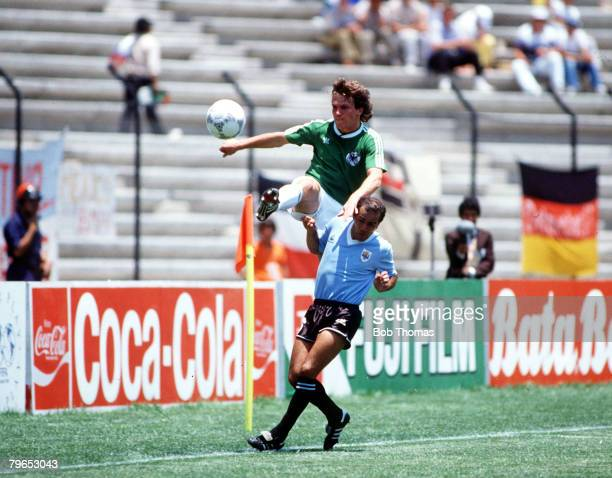 World Cup Finals Queretaro Mexico 4th June 1986 West Germany 1 v Uruguay 1 West Germany's Lothar Matthaeus clears the ball over Urugyan Jose...
