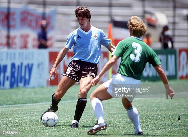 World Cup Finals Queretaro Mexico 4th June 1986 West Germany 1 v Uruguay 1 Uruguay's Miguel Bassio is faced by West Germany's Andreas Brehme