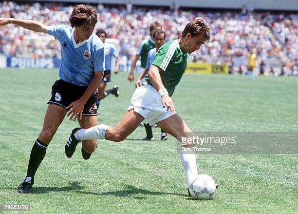 World Cup Finals Queretaro Mexico 4th June 1986 West Germany 1 v Uruguay 1 West Germany's Pierre Littbarski moves away with the ball from Uruguay's...