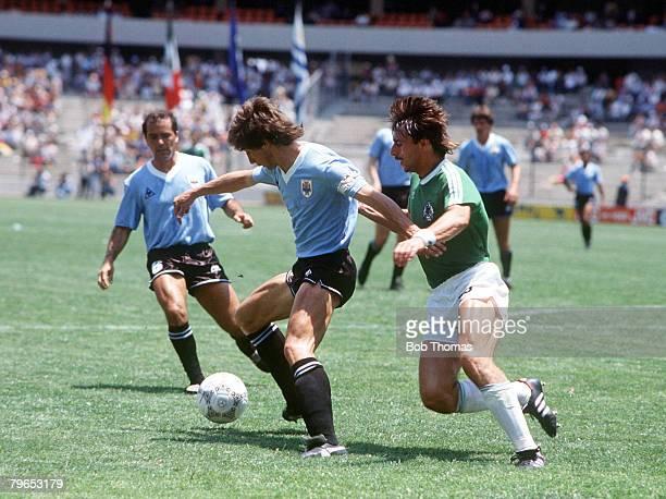 World Cup Finals Queretaro Mexico 4th June 1986 West Germany 1 v Uruguay 1 Uruguay's Eduardo Acevedo shields the ball past West Germany's Pierre...