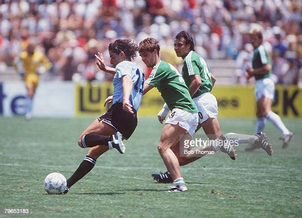 World Cup Finals Queretaro Mexico 4th June 1986 West Germany 1 v Uruguay 1 West Germany's Thomas Berthold challenges Uruguay's Sergio Santin for the...