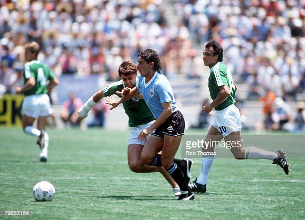 World Cup Finals Queretaro Mexico 4th June 1986 West Germany 1 v Uruguay 1 West Germany's Thomas Berthold and Uruguay's Sergio Santin battle for the...