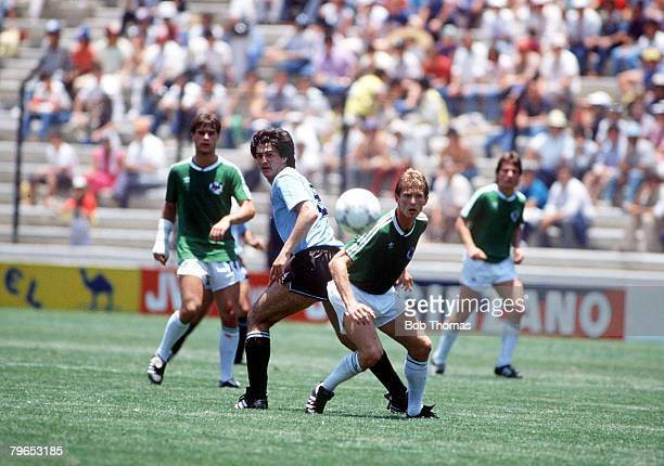 World Cup Finals Queretaro Mexico 4th June 1986 West Germany 1 v Uruguay 1 West Germany's KarlHeinz Foerster and Uruguay's De Silva keep their on the...