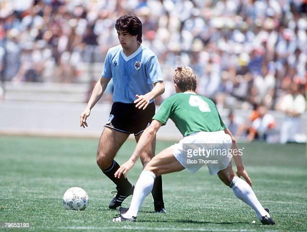 World Cup Finals Queretaro Mexico 4th June 1986 West Germany 1 v Uruguay 1 West Germany's KarlHeinz Foerster tries to stop Uruguay's De Silva