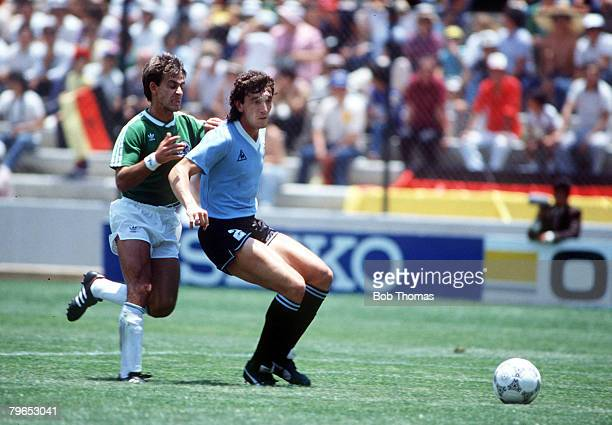 World Cup Finals Queretaro Mexico 4th June West Germany 1 v Uruguay 1 Uruguay's Nelson Guttierez and West Germany's Pierre Littbarski battle for the...