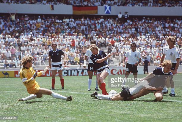 World Cup Finals Queretaro Mexico 8th June West Germany 2 v Scotland 1 Scotland's Steve Archibald and Frank McAvennie cause problems in the West...