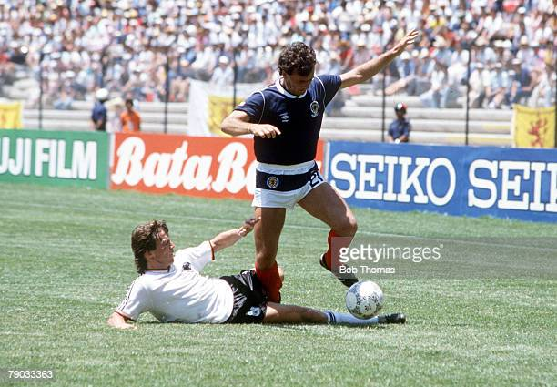World Cup Finals Queretaro Mexico 8th June West Germany 2 v Scotland 1 Scotland's Davie Cooper goes past West Germany's Lothar Matthaeus