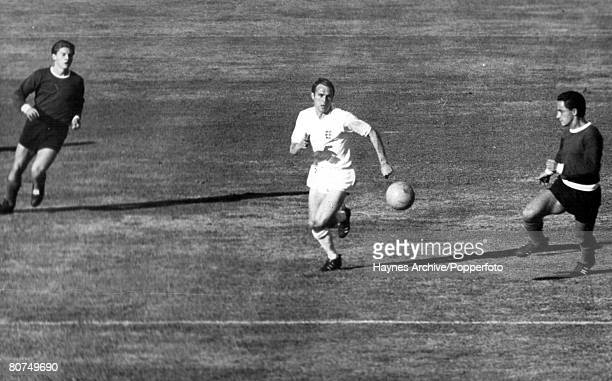 World Cup Finals Rancagua, Chile, 2nd June England 3 v Argentina 1, England's Ray Wilson clears the ball from two Argentine players during their...