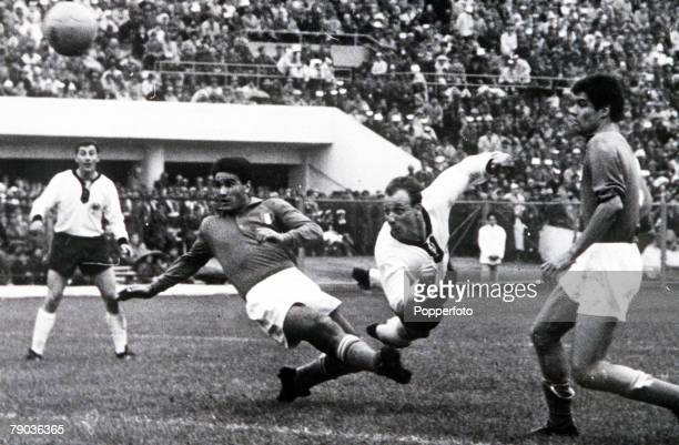 World Cup Finals Santiago Chile 31st May Italy 0 v West Germany 0 West Germany's Uwe Seeler dives to head the ball towards the Italian goal