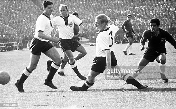 World Cup Finals Santiago Chile 6th June Germany 2 v Chile 0 West German defenders Szymaniak Erhardt ana Schnellinger stop Chile's Ramirez during...