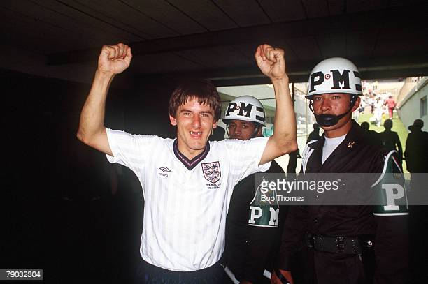 World Cup Finals Second Phase Azteca Stadium Mexico 18th June England 3 v Paraguay 0 England's Peter Beardsley celebrates his goal guarded by soldiers