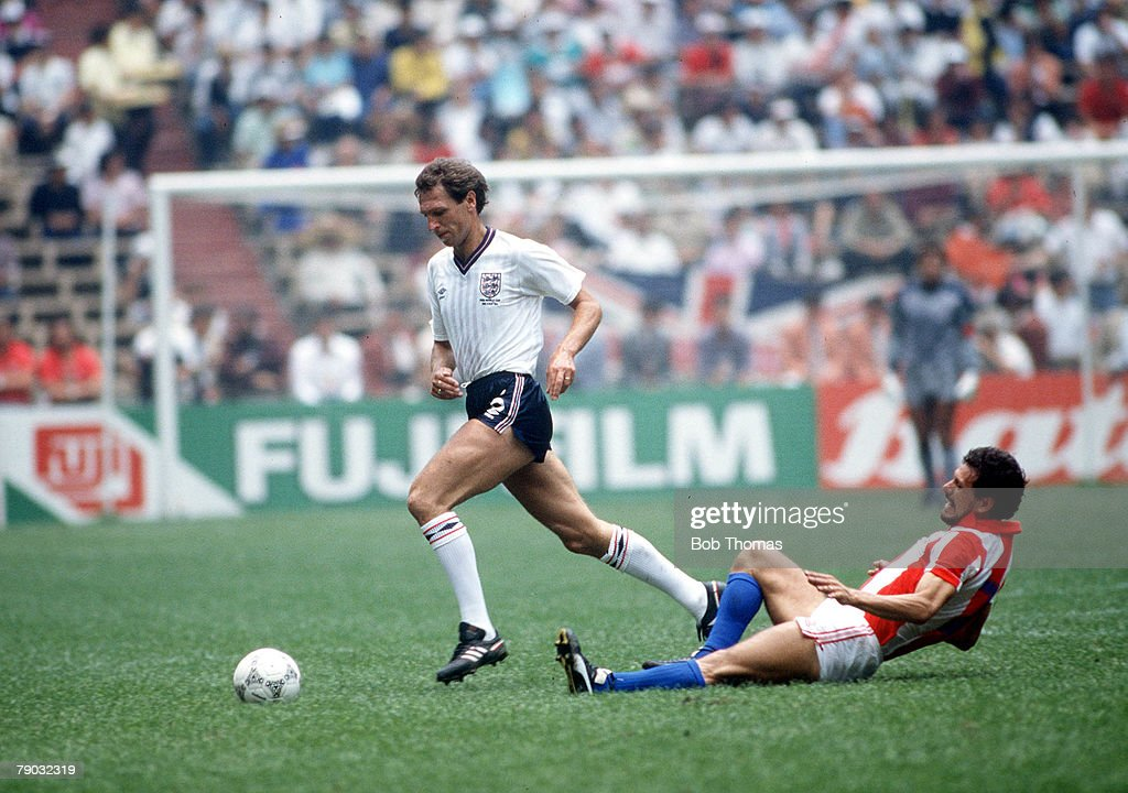 1986 World Cup Finals. Second Phase. Azteca Stadium, Mexico. 18th June, 1986. England 3 v Paraguay 0. England's Alvin Martin gets away from Paraguay's Buenaventura Ferreira. : News Photo