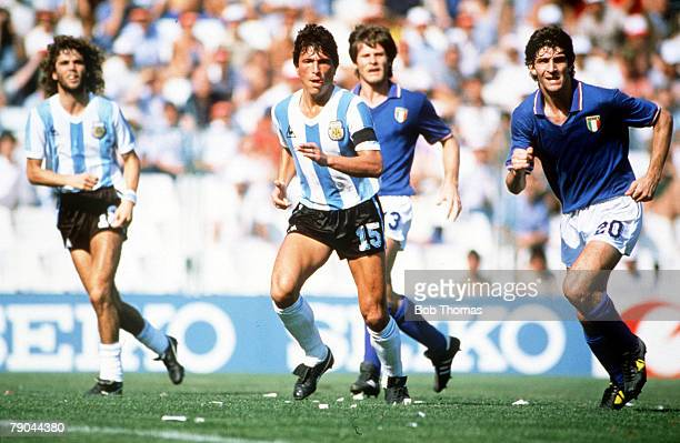 World Cup Finals Second Phase Barcelona Spain 29th June Italy 2 v Argentina 1 Italy's Paolo Rossi is followed by Argentina's Daniel Passarella