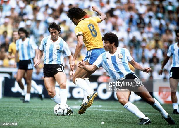 World Cup Finals Second Phase Barcelona Spain 2nd July Brazil 3 v Argentina 1 Brazil's Socrates clashes with Argentina's Juan Barbas