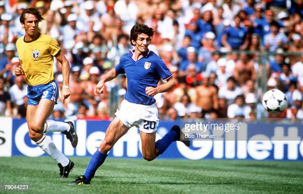 World Cup Finals Second Phase Barcelona Spain 5th July Italy 3 v Brazil 2 Italy's Paolo Rossi is watched by Brazil's Oscar