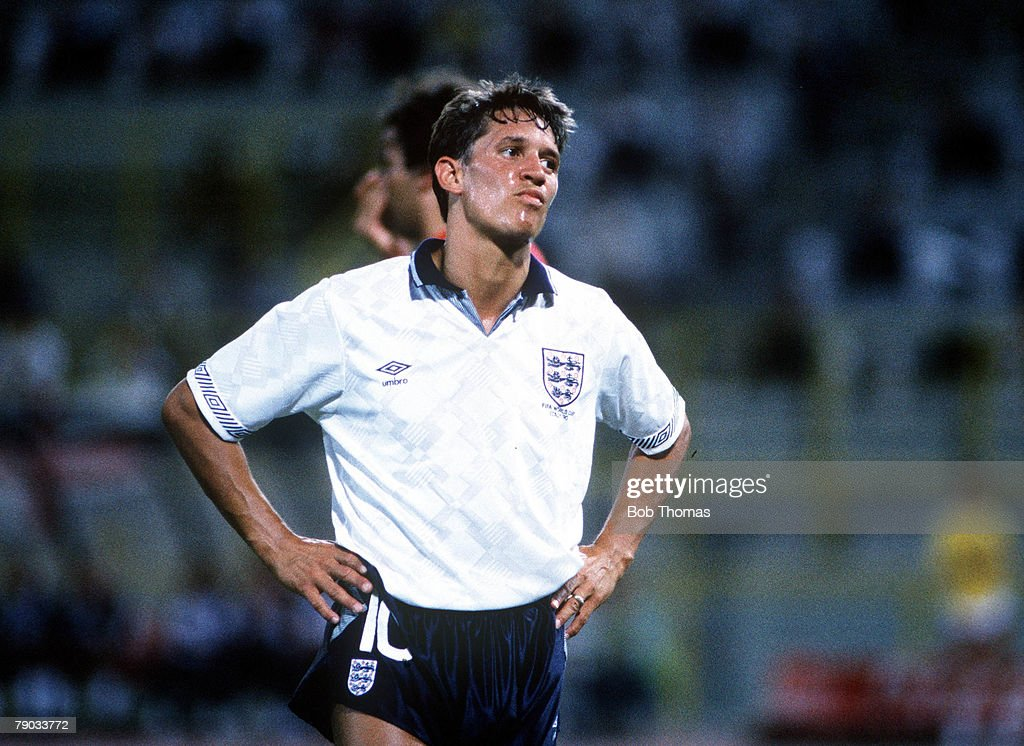 1990 World Cup Finals. Second Phase. Bologna, Italy. 26th June, 1990. England 1 v Belgium 0 (after extra time). England striker Gary Lineker looks annoyed as he stands hands on hips. : News Photo