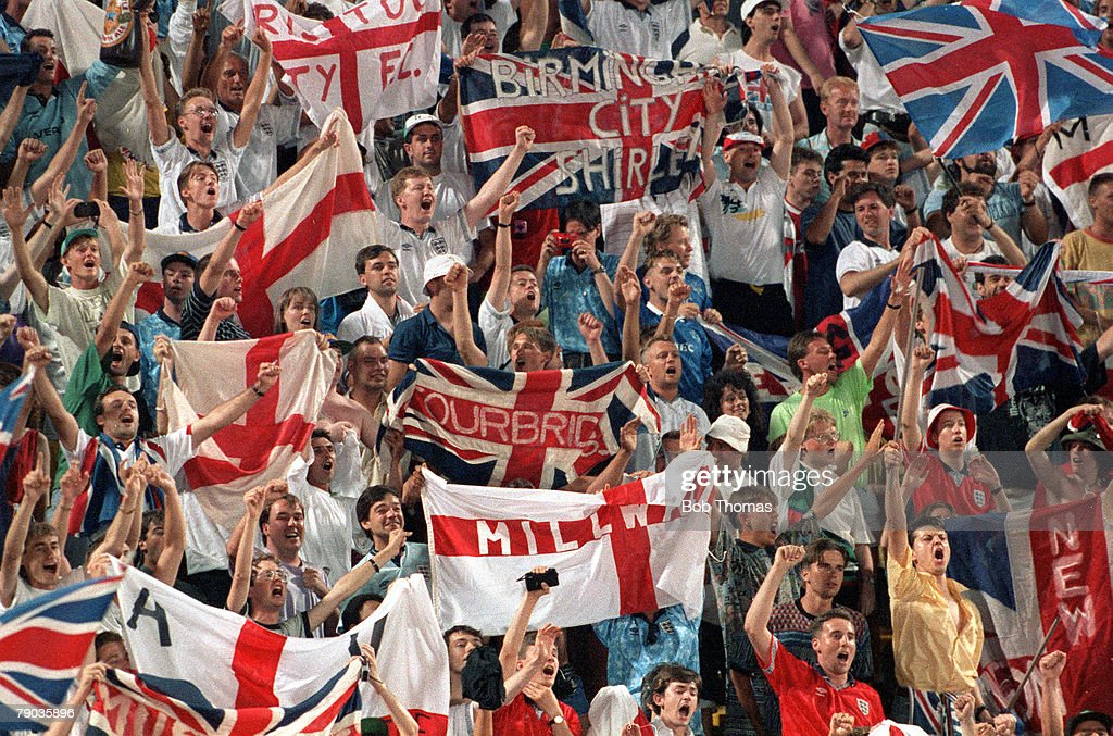 1990 World Cup Finals. Second Phase. Bologna, Italy. 26th June, 1990. England 1 v Belgium 0 (after extra time). A sea of England fans wave flags and banners to encourage their team during the match. : News Photo
