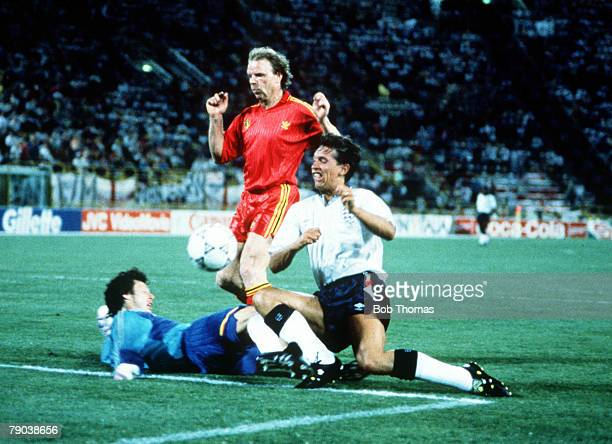 World Cup Finals Second Phase Bologna Italy 26th June England 1 v Belgium 0 England's Gary Lineker clashes with Belgian goalkeeper Michel Preud'Homme...