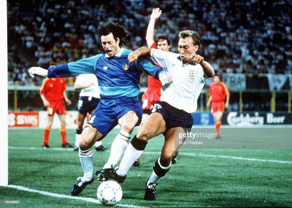 1990 World Cup Finals. Second Phase. Bologna, Italy. 26th June, 1990. England 1 v Belgium 0 (after extra time). Belgian goalkeeper Michel Preud'Homme holds off England's David Platt. : News Photo